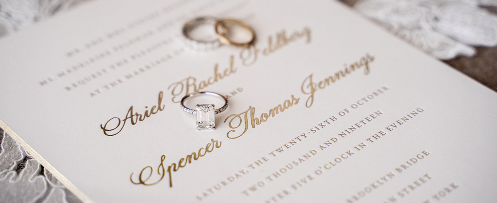 ariel and spencer wedding personal gold invitation and rings